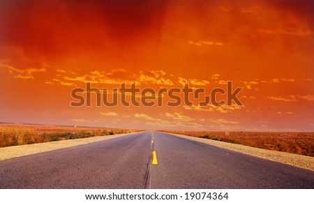 Desert Highway:Road travelling through a desert Field at Sunset(3) - stock photo