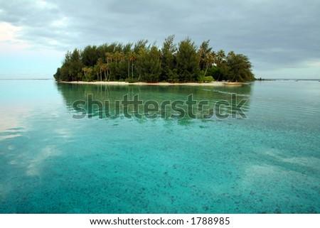 Desert island at sunrise in Moorea, French Polynesia - stock photo