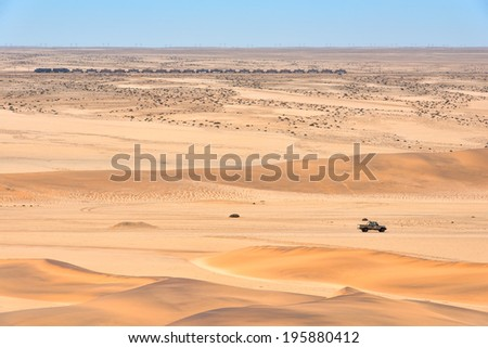 Desert landscape of Namibia with train and car visible - stock photo