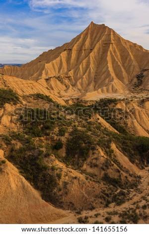 Desert landscape under the cloudy sky, Bardenas Reales, Navarra, Spain - stock photo