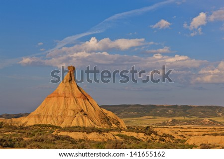 Desert landscape under the sunset colors, Bardenas Reales, Navarra, Spain - stock photo