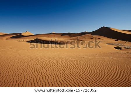 desert landscape with orange sand dunes in Namib at Sossusvlei, Namib-Naukluft National Park, Namibia, Africa - stock photo