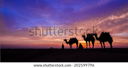desert man with camel and great sky settings.