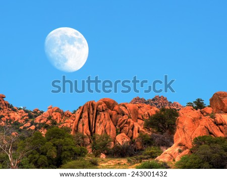 Desert moon over the southwestern USA desert and mountains - stock photo