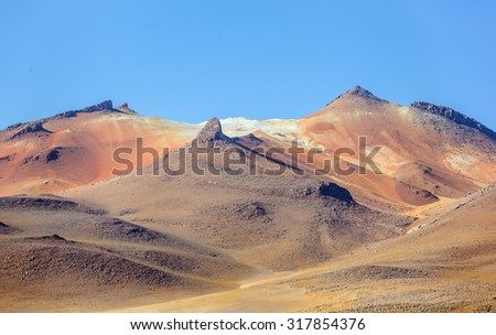 Desert plateau of the Altiplano (an ancient collapsed volcano on background) - Bolivia, South America