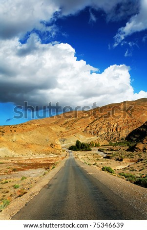 Desert road in Atlas Mountains, Morocco, Africa - stock photo