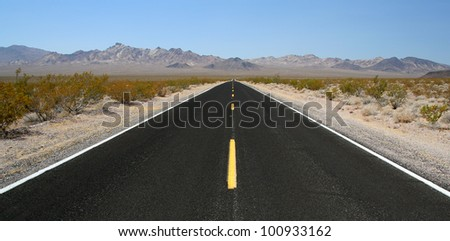 Desert road in Death valley, California - stock photo
