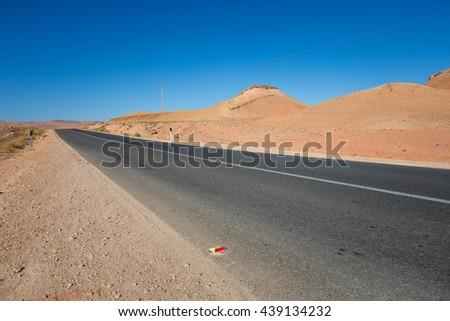 Desert road in Morocco - stock photo