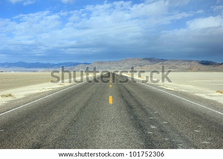 Desert road through bonneville salt flats, Utah.