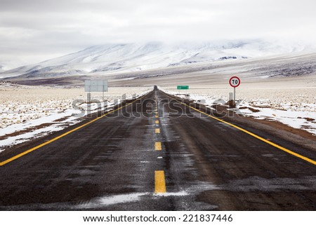 Desert snowy road - stock photo