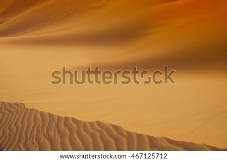 Desert. Yellow bright sands, silhouettes and lines of dunes, eroded.