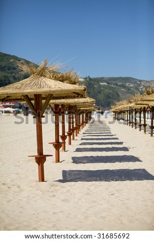 Deserted beach and beach umbrellas