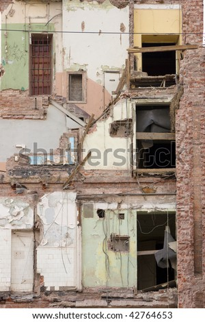 deserted building with fallen wall - stock photo