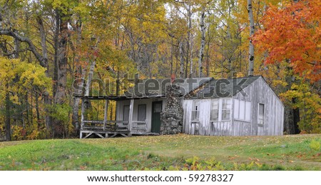 Deserted cabin in the woods - stock photo