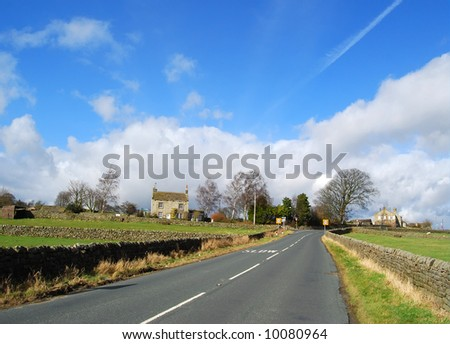 Deserted country road in Yorkshire Dale countryside - stock photo