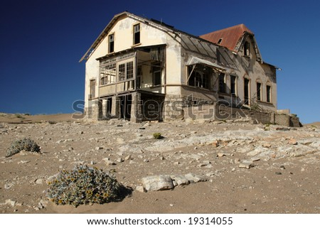 Deserted house in the abandoned diamond digging town Kolmanskop, Namibia