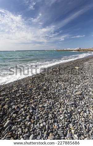 Deserted pebble beach in the southern city. - stock photo