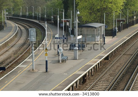 deserted railroad platform and junction; third of three views - stock photo