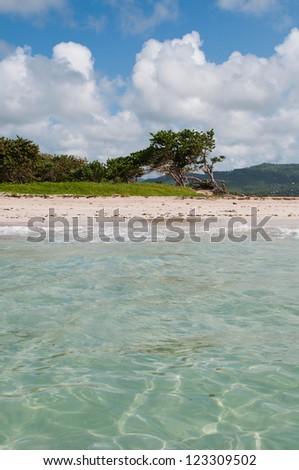 deserted sandy beach at Vieux Fort, Saint Lucia (ocean view) - stock photo
