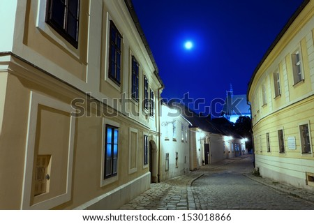 deserted street of Bratislava at night in a full moon - stock photo