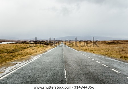 Deserted Stretch of a Mountain Road in Scotland on a Rainy Day
