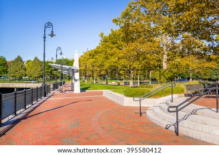Deserted   waterfront stone path  on a clear autumn day - stock photo
