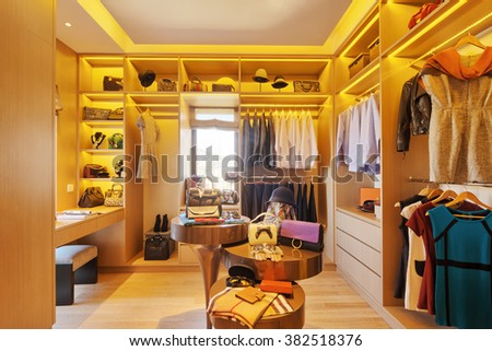 design and clothes in luxury wardrobe - stock photo