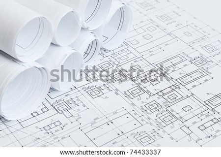 Design and project drawings rolled-up and sheets - stock photo