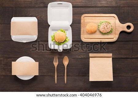 Design concept  brand of mockup burger set on wooden background. Space for text. - stock photo
