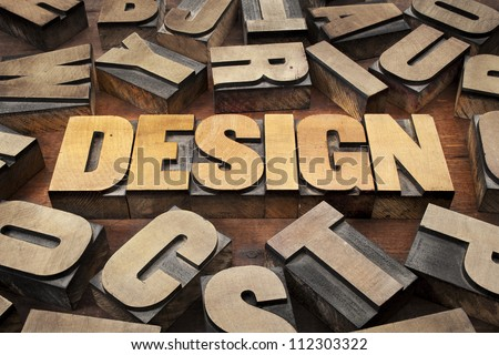 design concept in vintage letterpress wood printing blocks - stock photo
