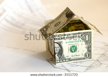 design drawings for construction of  house and monetary denominations of dollar simulating  house - stock photo
