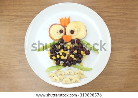 design food. Creative fruits for a child with a picture penguin - stock photo