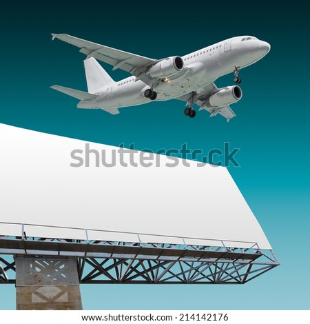Design of commercial airliner flying above billboard with empty background - stock photo