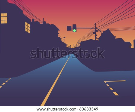 Design of green traffic light over an empty street at sunset