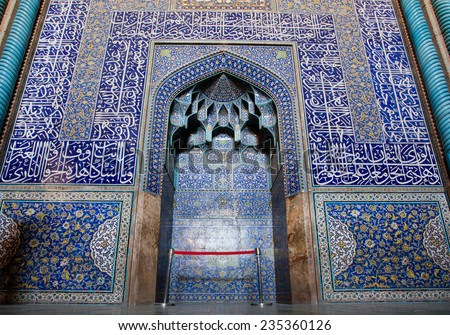 Design of the beautiful tiled symmetrical patterned Mihrab inside of unique Sheikh Lutfollah Mosque in Isfahan, Iran. Masjed-e Sheikh Lotfollah built in 1619 for powerfull Shah Abbas.  - stock photo