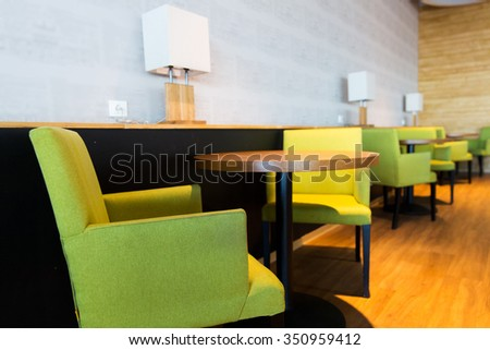 design, public place, furniture and interior concept - close up of restaurant interior with tables and chairs - stock photo
