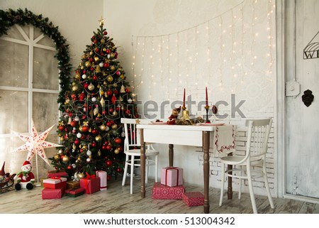 Design room with a Christmas fir. Festive background with table presents and arch