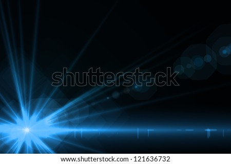 Design template - Star, sun with lens flare. Rays blue of light on a  black background - stock photo