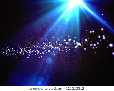 Design template - Star, sun with lens flare. Rays blue of light on a  blue background with particles - stock photo