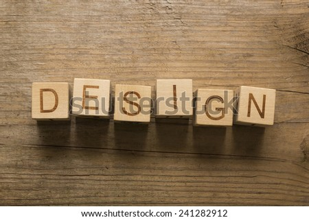 Design text on a wooden background - stock photo