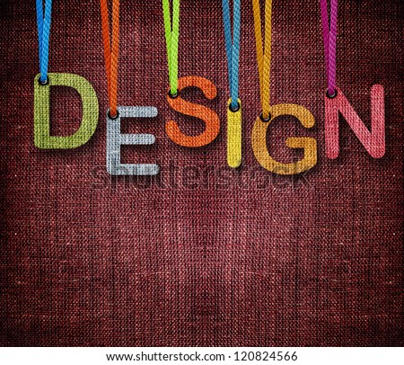 Design word hanging by rope as puppeteer on sackcloth background. - stock photo