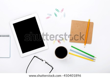 Design workspace. tablet, notebook, colored pencils, paper clips, glasses and cup of black coffee on a white background. top view, flat lay - stock photo