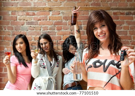 Designated driver drinking water at a party - stock photo