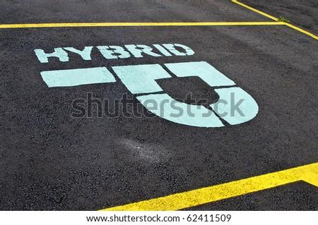 Designated parking spot for Hybrid car - stock photo