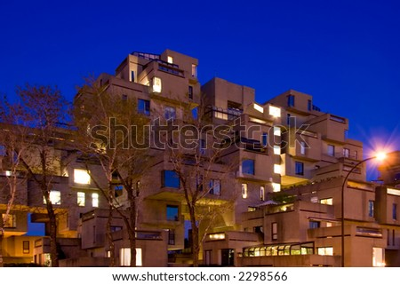 Designed by Moshe Safdie, the Habitat 67 appartment complex was constructed in the 1967 and it one of Montreal's most unusual landmark. - stock photo