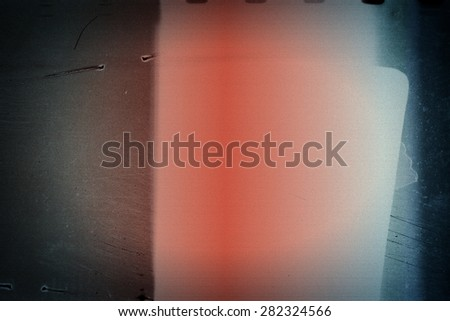 Designed film texture background with heavy grain, dust and light leak - stock photo