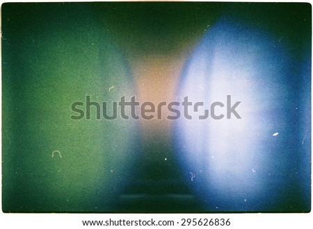 Designed green blue and yellow colors film texture background with heavy grain, dust and light leak