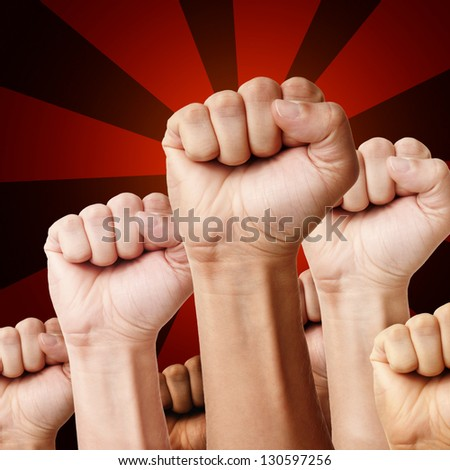 Designed illustration - raised up clenched fists of different ethnicity's men over red background - stock photo