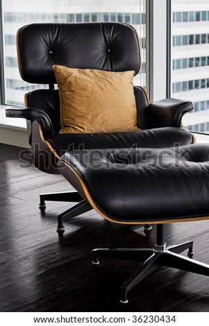 designer armchair in window with a cushion - stock photo