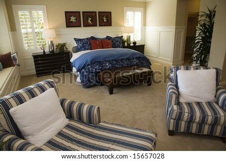 Designer bedroom with contemporary furniture. - stock photo